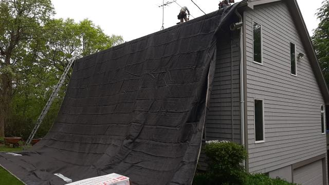 South Kingstown, RI - Roofing crew is taking extra care to protect this property during the roof replacement process. Cleaner when we leave. New roof no mess. New GAF Timberline shingles being installed. New roof being installed by 5 star roofing company