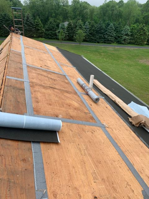 Griswold, CT - Taping the plywood seams on this roof in Griswold CT. New roofing code. Installing all GAF accessories as part of a golden pledge warranty. GAF Timberline shingles.