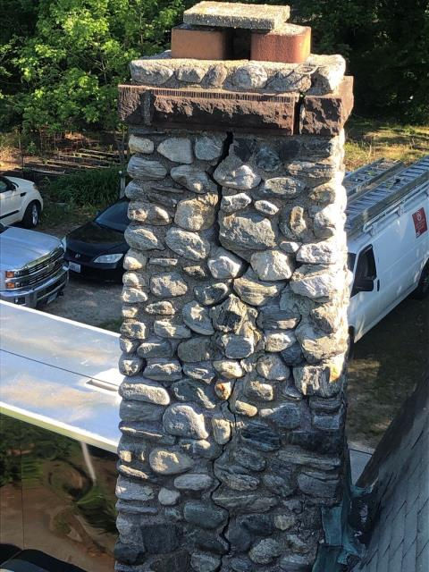 Griswold, CT - This chimney in Griswold CT will need to be repaired before the roof replacement. Large cracks and loose stones make this a unsafe situation.