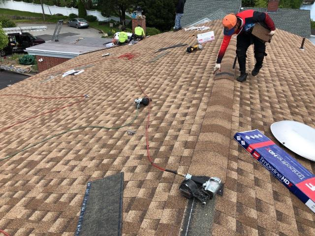 New London, CT - Roofing crew is finished with this roof replacement in New London CT. Installing the GAF Seal a Ridge cap shingles over GAF Cobra ridge vent. Another New GAF Roof system Complete!