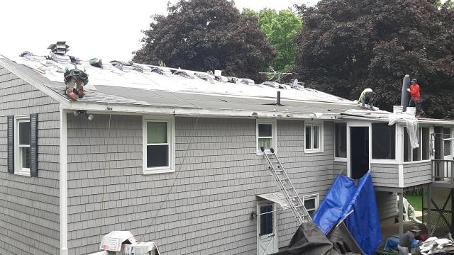 North Kingstown, RI - Roofing crew has installed all the new GAF accessories and is installing a small EPDM rubber membrane roof on this Home in North Kingstown RI. Golden Pledge warranty. GAF Timberline HDZ roof shingles.