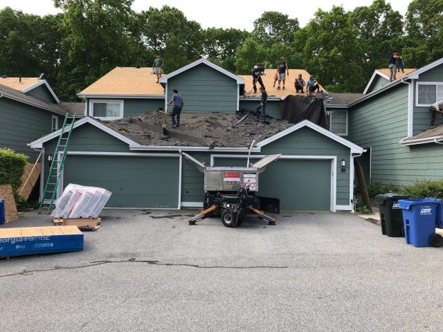 Groton, CT - New Roof No Mess! Using our Equipter to catch the roofing debris. Keeping the property protected and clean clean is a primary concern on a project of this size. Driveways are swept for nails daily!