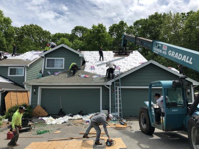 Groton, CT - All the GAF accessories have been installed and now the roofing crew is installing the New GAF TIMBERLINE HDZ shingles! Golden pledge warranty on these condo roofs.