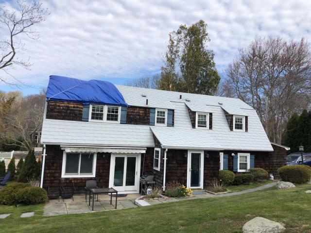 Westerly, RI - This metal roof in Westerly RI was damaged when a tree branch fell from high winds. Roof replacement to follow.