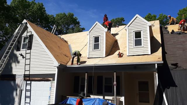 Voluntown, CT - Crew has removed the old layer of roof shingles and now is inspecting plywood sheathing for proper nailing and any damage. GAF accessories about to be installed before the GAF Timberline HDZ shingles get installed.