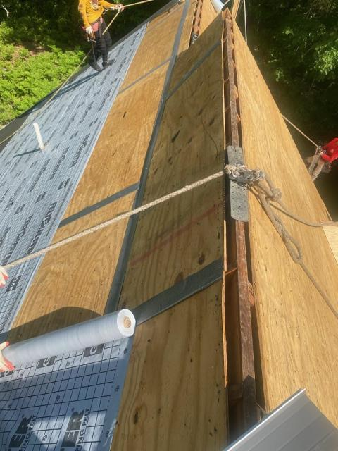 Voluntown, CT - Roofers are installing GAF Accessories.after nailing off loose sheathing and taping all plywood seams. Ridge vent was cut back to allow for proper ventilation. GAF Timberline shingles will be next. New roof one day! New roof no Mess!