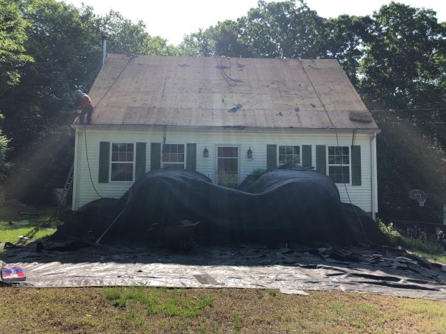 Ledyard, CT - Roofing crew has completed the removal of the old roof shingles. Inspecting existing sheathing .Next we will be installing the GAF Accessories then GAF Timberline HDZ roof shingles.