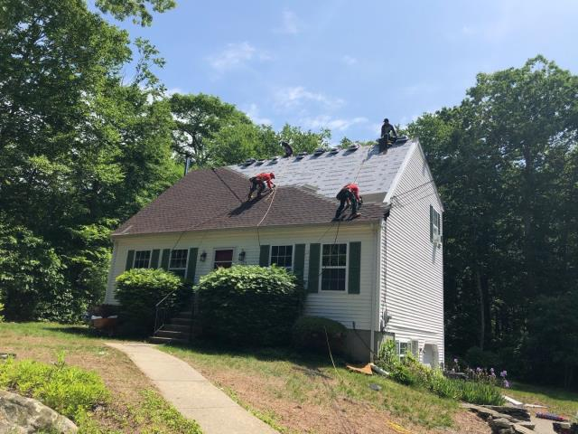 Ledyard, CT - This Roof replacement in Ledyard CT is moving along smoothly. The GAF Timberline HDZ shingles are being installed over the GAF Weather watch Ice & Water and the GAF feltbuster Synthetic roofing paper. All Crew members are wearing safty harnesses. Golden Pledge warranty.