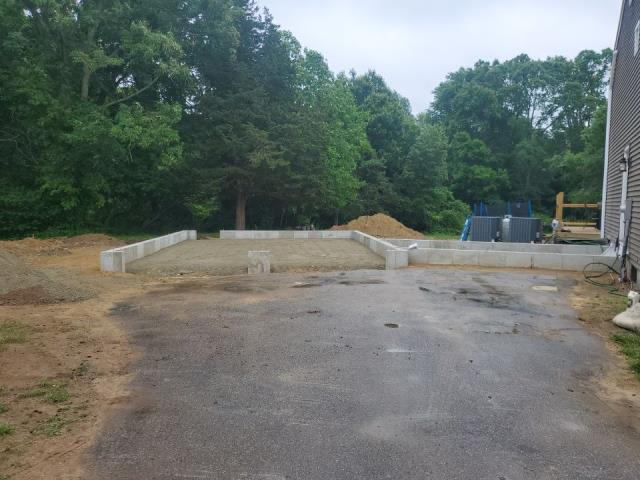 Preston, CT - Foundation and site work is complete and ready for our framers to get started with this two car garage addition in Preston CT.