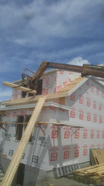 East Greenwich, RI - Measuring a new construction roofing project in East Greenwich RI.
