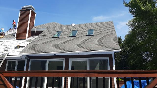 Narragansett, RI - Installing New Velux skylights during this full roof replacement in Narragansett RI. The old skylights were not opening and leaking.