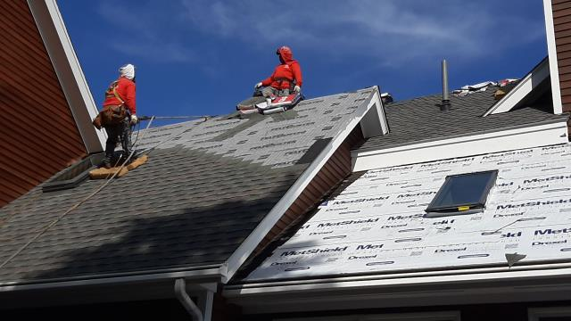 Narragansett, RI - Roofing crew is still on site installing  GAF Timberline roof shingles on this house in Narragansett RI. Color :Williamsburg Slate . Drexel Metal coming soon.