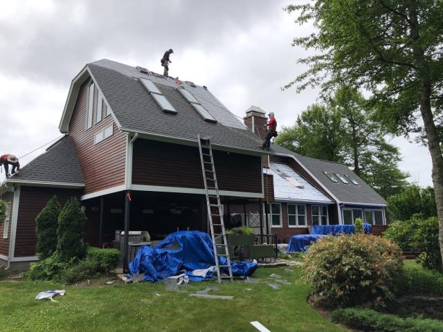 Narragansett, RI - Day three on this large roofing project in Narragansett RI. Replaced 9 old skylights with new Velux skylights. Installing a full GAF Roof system using all GAF accessories. Tomorrow we start the standing seam metal roof installation.