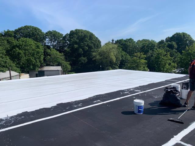 South Kingstown, RI - 100% silicone roof coating is being installed on this commercial EPDM rubber membrane roof in South Kingstown RI. This silicone coating will be adding 40 years to the life of the roof and help property owner save on energy costs!