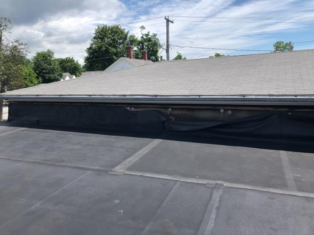 South Kingstown, RI - Measuring a commercial EPDM rubber membrane roof today in South Kingstown RI. Existing rubber roof will be removed and new insulation board will be installed and a new EPDM rubber membrane system will be installed. Asphalt roof shingles will be removed new sheathing installed and GAF Timberline HDZ shingles installed on main roof.