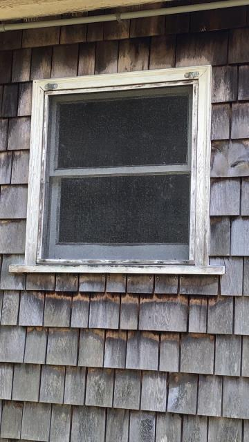 Exeter, RI - Measuring for replacement windows on this property in Exeter RI. New Vinyl windows will operate smoothly and help with energy costs. Trim will be wrapped with aluminum to cut down on painting. New cedar impressions would be a great low maintenance option for siding.