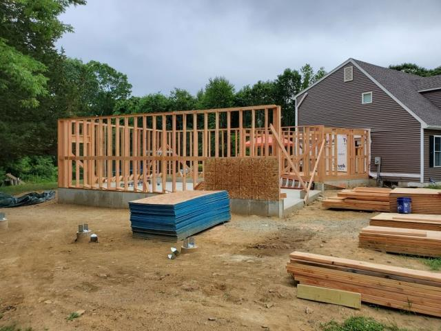 Preston, CT - New garage framing is under way in Preston CT. All new Vinyl siding and GAF shingles will be used and will match existing house