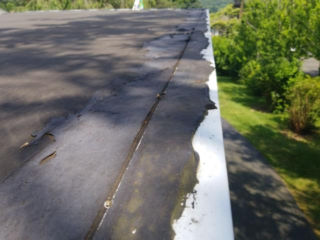 Waterford, CT - EPDM rubber membrane needs to be replaced on this flat roof in Waterford CT. New EPDM will be installed after old roofing is removed.