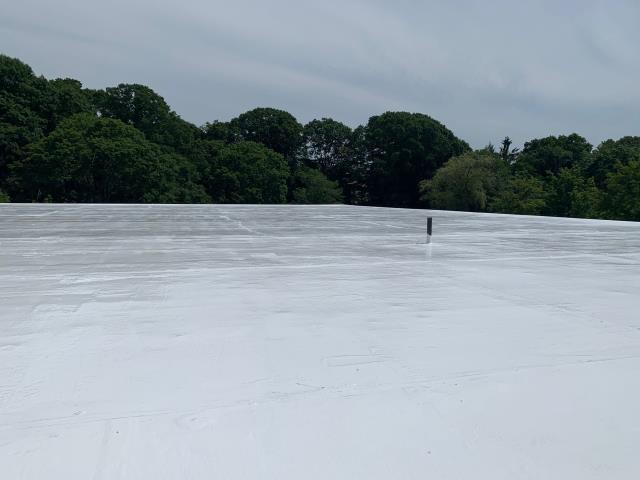 South Kingstown, RI - This commercial roof coating project  has just been completed in South Kingstown RI. 100 Percent silicone coating was applied after the entire surface was washed and repaired as needed. 40 Year warranty backed by company. Solar panels will be installed next!