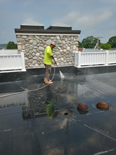 Stonington, CT - Our Commercial Roofers in Stonington CT are preparing this EPDM rubber membrane for a new GACO roof coating. There are many benefits to using a roof coating instead  of replacing the EPDM rubber roofing. Roof coatings in CT and RI are getting more popular!