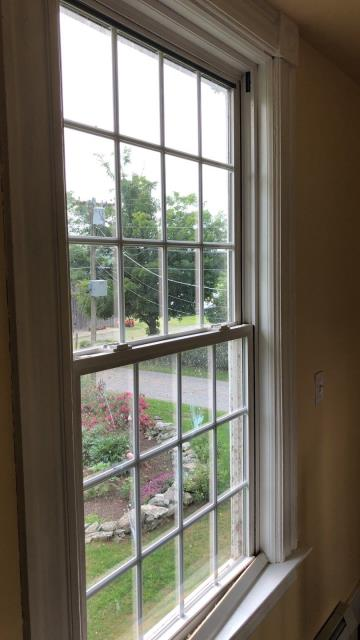 Griswold, CT - Measuring for new Harvey vinyl Replacement windows in Griswold ct.