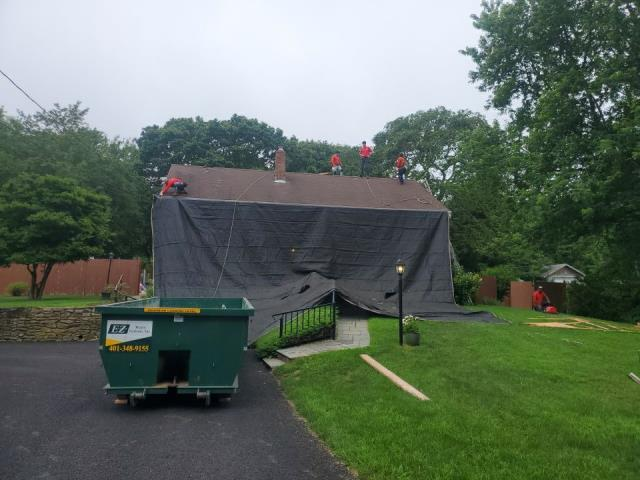 Stonington, CT - Our roofers are in Pawcatuck today stating a new roof project. Today our carpenters will be adding a new decorative dormer to this home as our roofing crew removes the old shingles and installs a new GAF Roof system! All in one day.