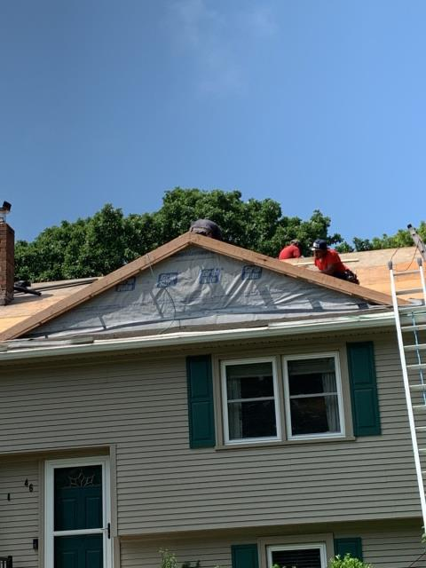 Stonington, CT - Carpenters moved dormer back for a softer look. New vinyl siding will be installed after the roof installation is complete.