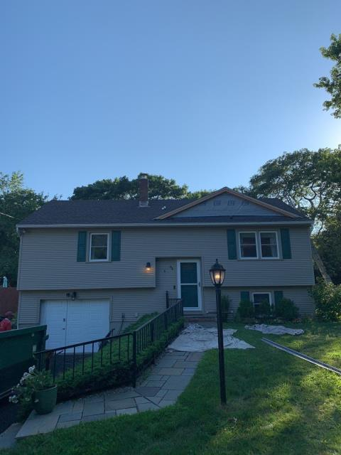 Stonington, CT - And just like that a new roof in Pawcatuck CT! Roofers just completed this full roof replacement in One day and added anew dormer. GAF shingles installed.