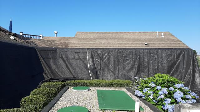 South Kingstown, RI - Our roofing Crew is in South Kingstown RI setting up heavy duty tarps to protect this house during it roof replacement. This property is getting a new GAF Timberline Roof installed.
