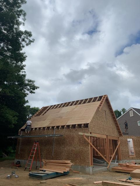 Preston, CT - The building of this attached two car garage in Preston Ct is almost ready for its GAF Roof system to be installed. And its new Harvey Windows and vinyl siding
