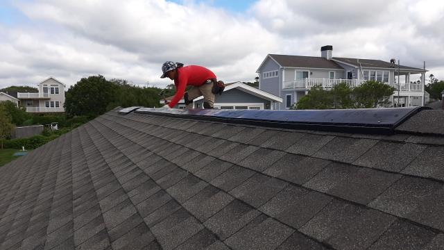 South Kingstown, RI - One of our crew members is installing the GAF Snow Country ridge vent and the GAF Timbertex ridge Cap shingles. Hand nailing the cap ensures that it is done correctly and will hold up to the high winds.