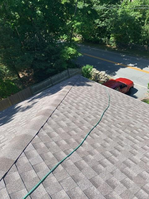 North Kingstown, RI - This roof is just about complete! Roofers just installed the new GAF Seal a Ridge cap shingles on this hip roof. Color Mission Brown, Warranty Golden Pledge