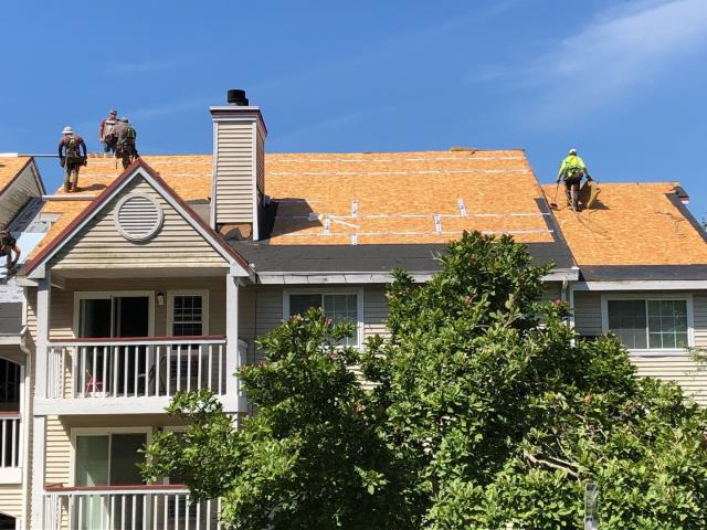Jupiter Point, CT - Our roofers are taping the sheathing seams and installing The GAF accessories to get this roof watertight before days end. GAF Timberline HDZ roof shingles will be installed next