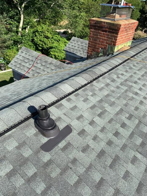 Charlestown, RI - This Roof replacement in Charlestown RI is almost complete! Ultimate pipe flashing and Snow country ridge vent are just two of the upgraded accessories used on this new roof that will help protect this roof for many years! Both of these accessories are covered by GAF as part of the Golden Pledge Warranty!