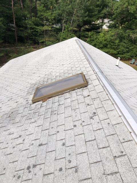 Charlestown, RI - This old three tab roof in Charlestown RI will be getting replaced using the best shingles on the market. A new GAF Timberline HDZ roof shingle will be installed with a Golden Pledge warranty. These old shingles will be removed first and the skylight will be replaced using a new  VELUX vented skylight.