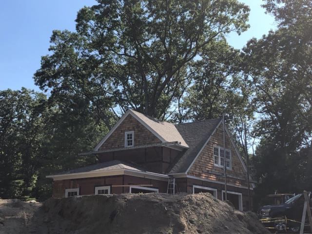Point Judith, RI - This new construction project is moving along in Narragansett RI! New owens corning roof shingles installed to match the existing house. Red cedar siding
