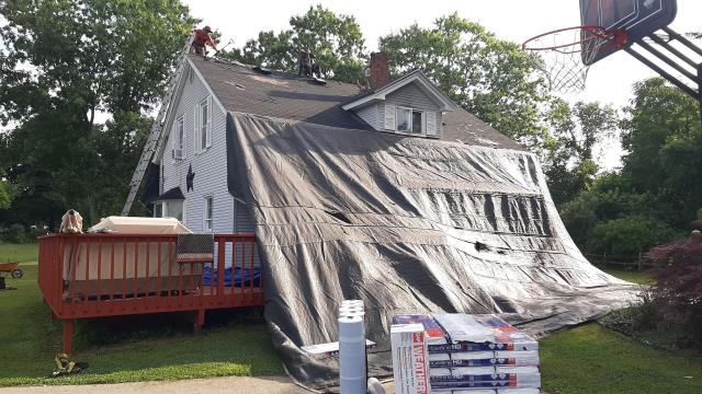 Hopkinton, RI - Another roof in Hopkinton RI is under way! Heavy duty tarps are set up to protect the property from Damage. All the GAF Roofing material is on site and ready for another quality roof installation