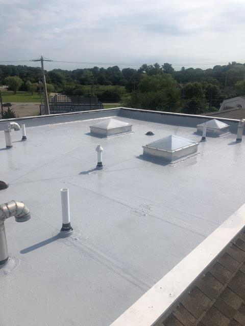 Stonington, CT - One of two commercial roofs getting a new 100 % silicone roof coating applied in Stonington CT. Roof was cleaned and prepped before coating was applied. 40 Year warranty. This new white roof coating should help lower cooling costs.