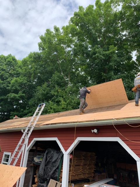 Sterling, CT - Roofing crew is installing new half inch CDX plywood sheathing over the old roof deck to give proper nailing surface for the new GAF Timberline roof shingles to get installed in Sterling CT.
