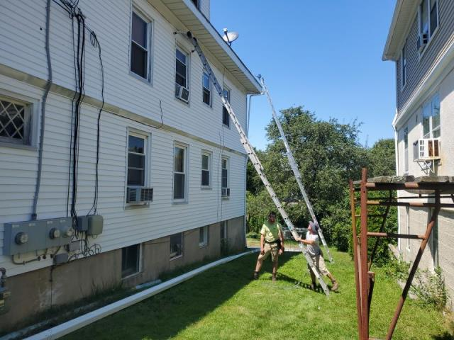 Westerly, RI - Replacing the aluminum trim on this rental property in Westerly RI. Then installing new Seamless gutters.