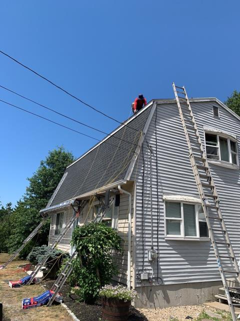 Westerly, RI - Our roofers in Westerly RI are doing great today on this full roof replacement despite the heat!All new flashings are being installed on this roofing  project.  Installing new GAF Timberline HDZ roof shingles. Color charcoal
