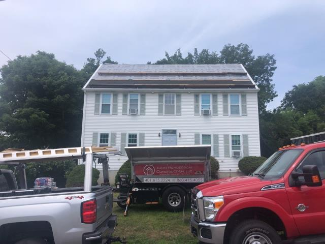 Westerly, RI - Our roofing crew is making progress on this roof replacement project in Westerly RI. The equipter has been a huge help on these recent roof projects in westerly. All new GAF Timberline shingles will be installed.