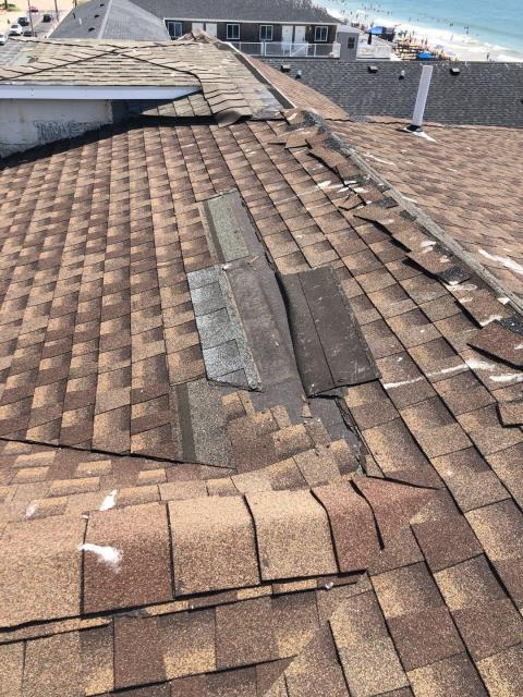 Westerly, RI - Storm damage to this roof in westerly RI. These shingles were never nailed properly and have blown off the roof from the high winds. Poor workmanship is not covered by Insurance. High a professional company who is trained by the roofing manufacture. Master Elite Contractor in RI and CT.