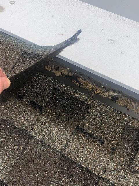 Stonington, CT - Here is an example of some shingles that were damaged in a recent storm in Stonington CT. High winds will damage the seal on the shingles. Dirt an debris can get between the shingles and not allow them to reseal. This leak will be repaired by one of our roof technicians.