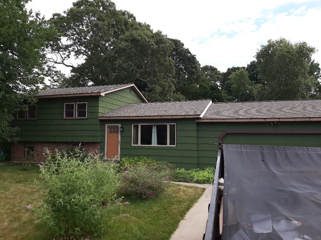 Westerly, RI - Just finished roof replacement. GAF Timberline HDZ Architectural shingles in Mission Brown. Homeowners chose the Weather Stopper Silver Pledge, which covers manufacturers defects for 50 years, and workmanship for 10.