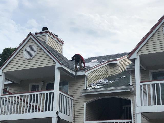Jupiter Point, CT - Roofing crew is wrapping up this roof in Groton CT before the weekend! New GAF Roof system being installed. Golden Pledge Warranty. Master Elite. Presidents club roofing company.