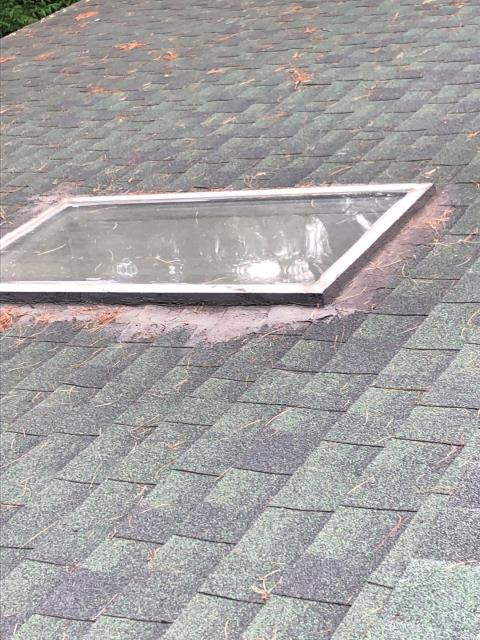 Richmond, RI - Measuring for a new Velux skylight in Richmond RI in need of replacement. The best time to replace your old skylight is while doing your roof replacement.