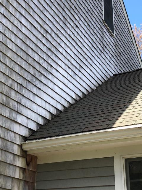 South Kingstown, RI - Cutting  the old siding to replace the old step flashing is a tough job but well worth the time! Replace with new Azek trim and new step flashing as part of the Golden Pledge warranty
