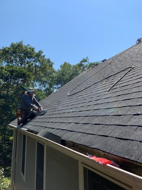 Point Judith, RI - New stainless steel  gutter guards are being installed as part of this full roof replacement job in Narragansett RI. First the existing gutters are cleaned of all debris.