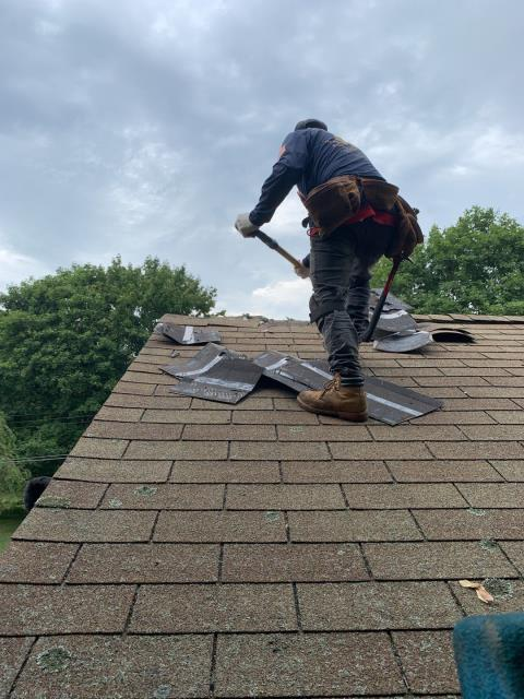 Waterford, CT - Roofing crew is on site starting to remove the old roof shingles on one of today's roofing projects in Eastern CT. A new GAF Timberline roof shingle will be installed. New EPDM Rubber membrane roofing will also be used in some areas where the roof is not pitched.